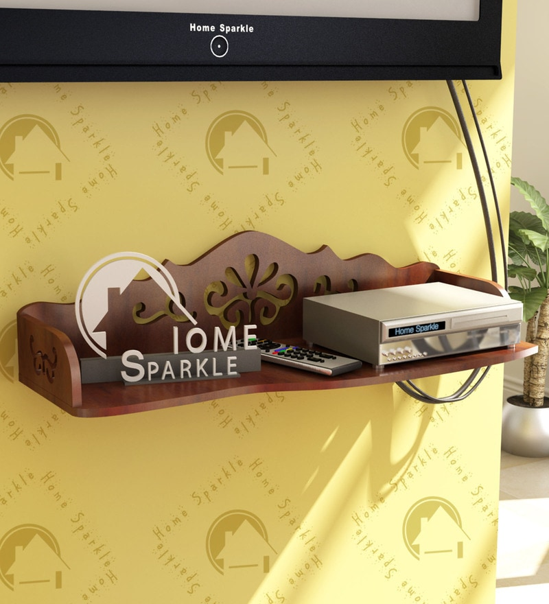 Brown Engineered Wood Carved Wall Shelf by Home Sparkle