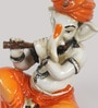 Orange and Brown Synthetic Fibre Lord Ganesha Playing Flute by eCraftIndia