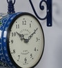 Blue Iron 9 x 5.4 x 12.5 Inch Hand Painted Alluring Victoria Station Wall Clock by Medieval India