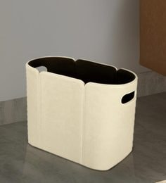 Milton Magazine Holder With Curved Edges & White Stitches In Off White Leatherette