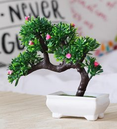 Multicolour Plastic Artificial Plant Bent With Green Leaves And Pink Flowers