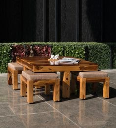 Patal Coffee Table Set With Four Stools In Teak Finish