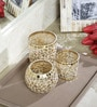 Deeprabha Tea Light Holders Set of 3 in Gold by The Decor Mart