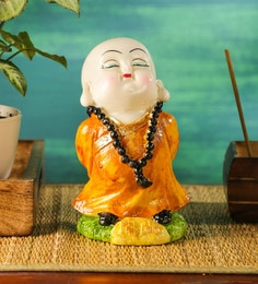 [Image: yellow-polyresin-musical-buddha-idol-by-...grubri.jpg]